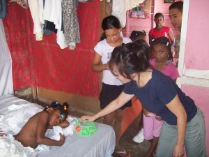 Julie and her girls encourage and pray for Induaba